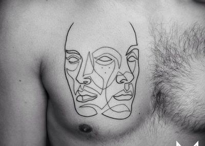 Тату лайнворк лицо на груди
