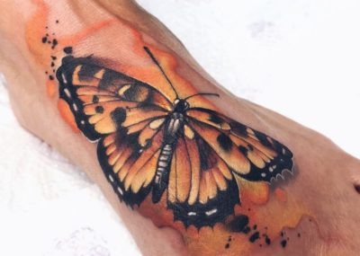тату акварель на ступне бабочка