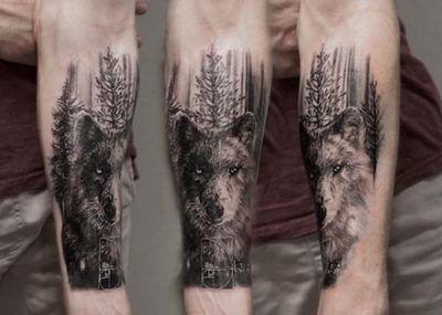 тату волк лес на руке