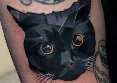 тату черный кот
