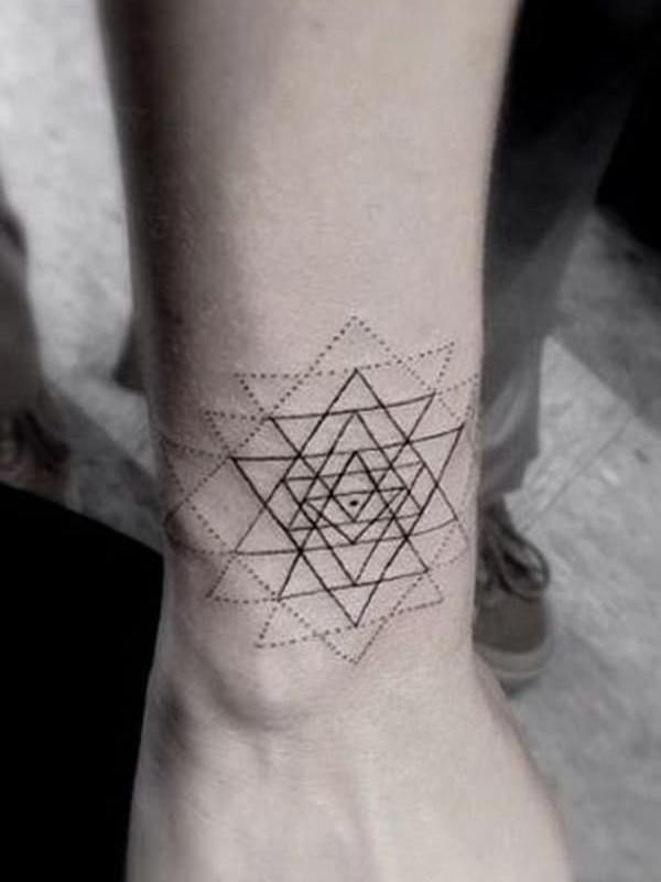 Geometric pattern circle tattoo