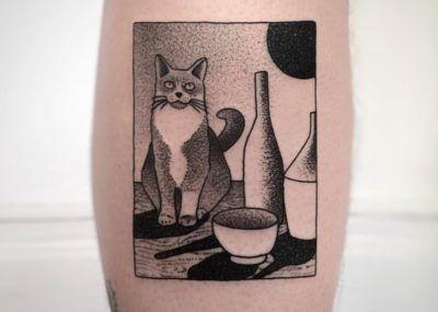 татуировка кот и молоко