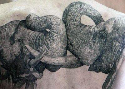 тату слоны дерутся
