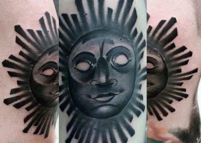 Blackwork sun tattoo