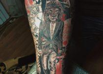 Стиль реализм в тату на руке лев