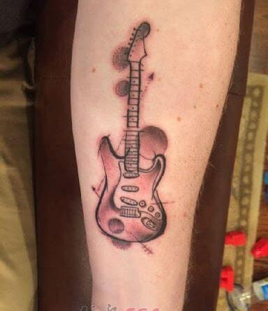 Тату гитара и планеты